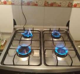 Estufa de 4 hornillas con Horno en buen estado