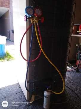 Cargo gas y reparo  Heladeras, freezer y aires acondicion