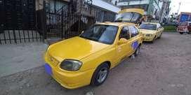 Vendo vehículo tipo taxi, hiunday 2005
