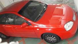 Vendo optra rojo 2006 con A/C