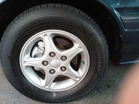 """Rines de lujo 14"""" Mazda con llantas"""