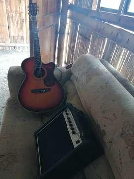 Guitarra  eléctrica y manual marca primax en buenas condiciones con amplificador incluido