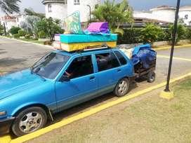 Servicios de transporte y carga y mensajería económico