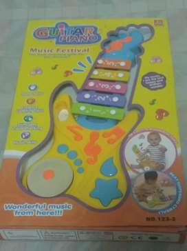 Guitarra xilófono de juguete sin uso