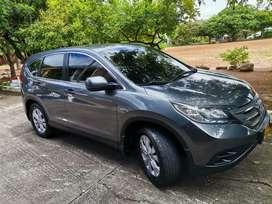 Se vende o se permuta por vehículo de menor valor camioneta Honda en excelente estado