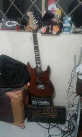 Guitarra, pedalera y amplificador