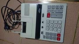 Antigua Calculadora electrica a papel CIFRA 211 PV  funciona