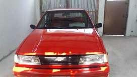 Se vende o se cambia con camioneta hermoso auto chevrolet 5 puertas