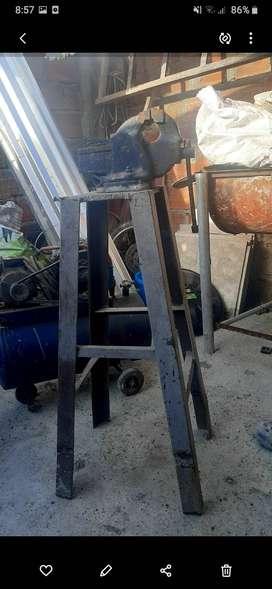 Sevende: esmeril, compresor, soldador, prensa y taladro