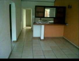 Sala, comedor, cocina, 3 habitación 2 con closets, 1 baño y medio , patio y ante jardín pequeño