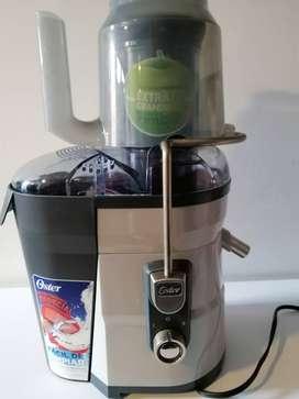 Extractor de frutas y vegetales Oster