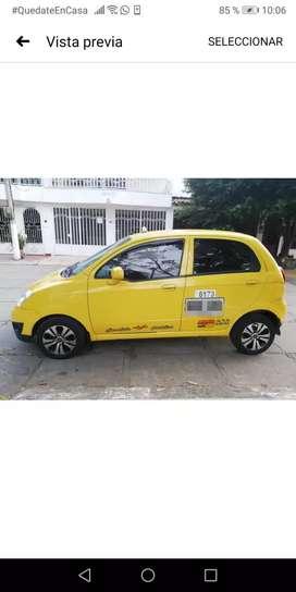 Vendo taxi spark lindo y bello con aire acondicionado papeles hasta el otro año