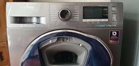 Lavadora secadora Samsung WD11K6410OX de carga frontal con sanitizador y puerta de adicion de ropa activa.