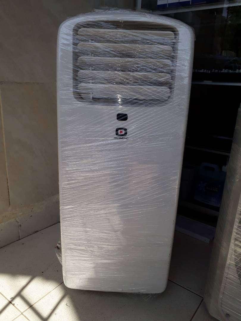 se vende potente aire acondicionado portatil marca olimpo de 12000 btu 0