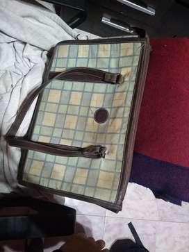 Valija de mano, mochila y bolso escolar