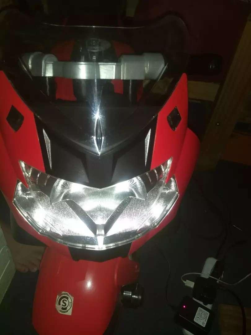 Moto a batería BMW 12v 3 velocidad. Permuto TMB 0